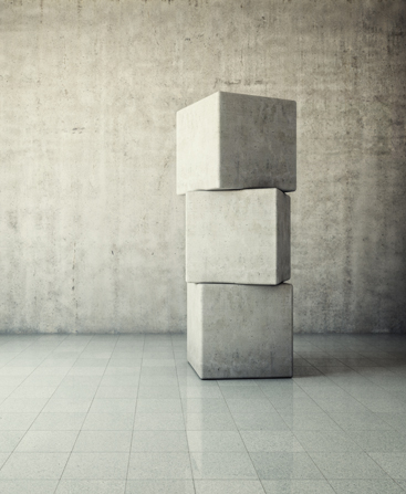 Three concrete cubes stacked up